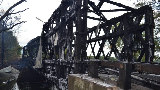 The Vermont State Police are investigating a fire that destroyed the Station Covered Bridge between Cornwall and Salisbury on Saturday, Sept. 10, 2016.