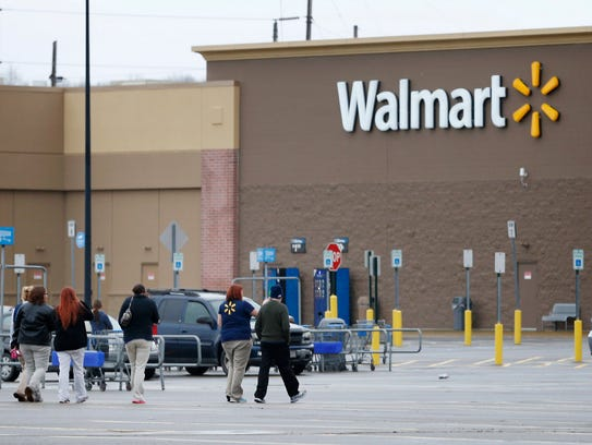Walmart employees in Horseheads walk to re-enter the