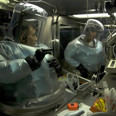 Two Army scientists run tests in a BSL-3 chamber at Utah's Dugway Proving Ground. This is the same facility that recently shipped live anthrax specimens to as many as 18 labs in nine states, according to CDC officials.
