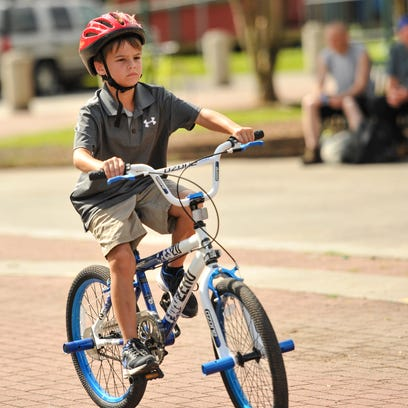 Bryce David rides his bike at Parc Sans Souci in Lafayette.
