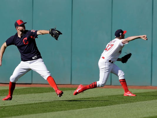 Cleveland Indians starting pitchers Corey Kluber, left, and Trevor Bauer throw during a baseball workout, Tuesday, Oct. 3, 2017, in Cleveland. The Indians will play the winner of the wild card game between the New York Yankees and the Minnesota Twins in the ALDS on Thursday. (AP Photo/Tony Dejak)