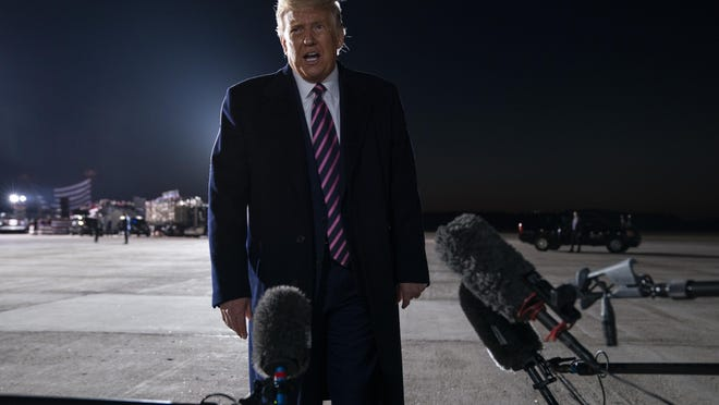 President Donald Trump talks to reporters about the death of Supreme Court Justice Ruth Bader Ginsburg, after a campaign rally, Friday, Sept. 18, 2020, in Bemidji, Minn.