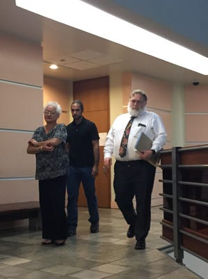 Timothy John Hubert, middle, leaves the courtroom after pleading guilty to invasion of privacy on Nov. 16, 2016. Hubert admitted to installing camera in a nightclub restroom.