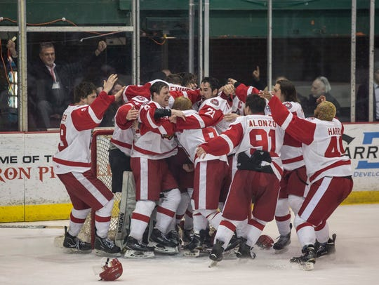 Prowlers players celebrate winning the Commissioner's