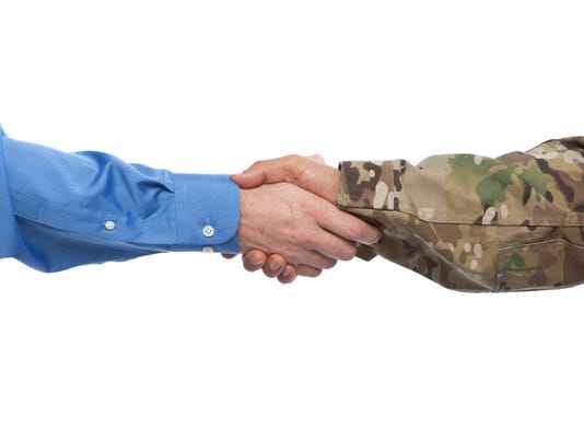 Military and Businessman Handshake