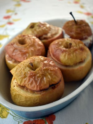 These baked apples are filled with spiced oatmeal.