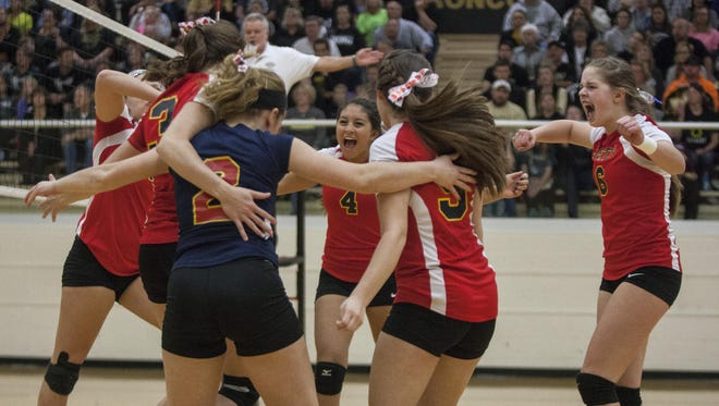 Seton Catholic celebrates a point during the Class A Daleville Regional at Daleville. Seton Catholic won 3-1.