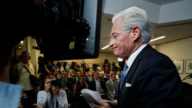 Marc Kasowitz personal attorney of President Donald Trump, leaves a packed room at the National Press Club in Washington, Thursday, June 8, 2017 after delivering a statement following the congressional testimony of former FBI Director James Comey.