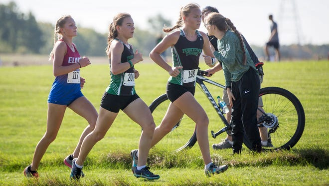 Yorktown's Indira Brown, center, and Madeline Aul help lead the top 10 runners at the IHSAA Regional on Oct. 14 at the Muncie Sportsplex. Yorktown won the meet overall with Brown placing 6th and Aul placing 8th.