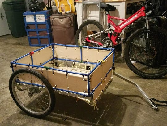 Hites' trailer, which he pulls behind his bike, stores