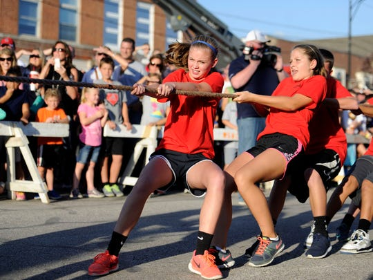 Helfrich Park students pull a rope during the West