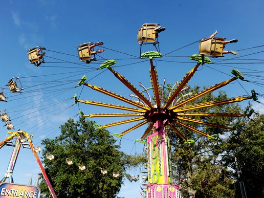 Festival goers enjoy one of the many rides during the