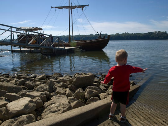 Jack Arvin, 2, of Newburgh, Ind., tosses rocks into the Ohio River where the keel boat and a pirogue are tied to the pier at Newburgh Lock and Dam Park Monday morning. The Corps of Discovery group was reenacting the original 1803 trip downriver by Lewis and Clark.