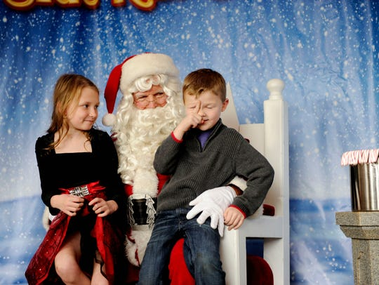 Madelyn Beck and Preston Beck tell Santa what they