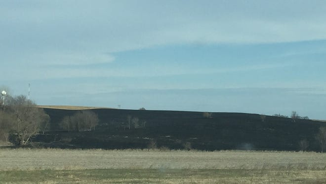 The aftermath of a large field fire near Conroy Sunday afternoon, April 22.