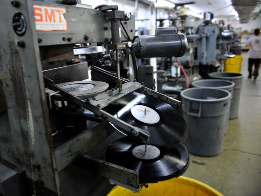 Vinyl records are made at the United Record Pressing company, one of the nation's leading vinyl record makers, in Nashville, Tenn., Friday, May 2, 2014.