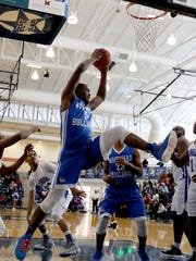 Woodward's Terry Durham grabs a rebound during the