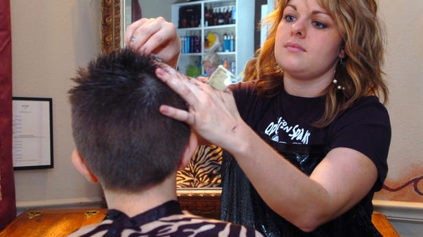 TRN File photoHair stylist Randi Sinclair was one of ten stylists giving shampoos and haircuts to over 200 children during Operation Spa Kids at Spa Bella in 2015.