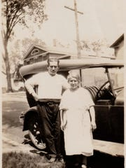 Abraham and Lillian Allen from Lebanon at 82 S. Champlain St. with their new car.