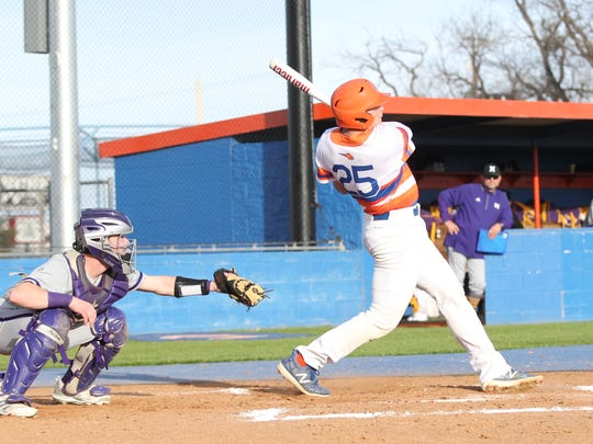 San Angelo Central High School's Nixon Brannan takes a big swing against Midland High during a nondistrict baseball game at Nathan Donsky Field on Tuesday, March 6, 2018.