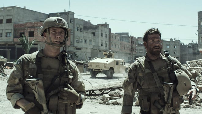 Biggles (Jake McDorman) and Chris Kyle (Bradley Cooper) struggle to keep the enemy at bay on the streets of Iraq.