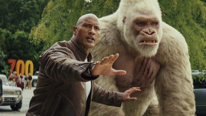 "Davis (Dwayne Johnson) has bonded with a gorilla in ""Rampage."""