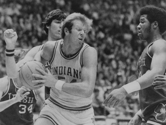 Indiana's Kent Benson takes a rebound away from Bruce Flowers (34), Bill Laimbeer and Adrian Dantley (right) of Notre Dame during the first half of the Dec. 12, 1975 game at Assembly Hall. Indiana won, 63-60