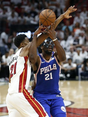 76ers center Joel Embiid, right, is defended by Heat center Hassan Whiteside during the first period of Game 4 of their Eastern Conference playoff series on Saturday.