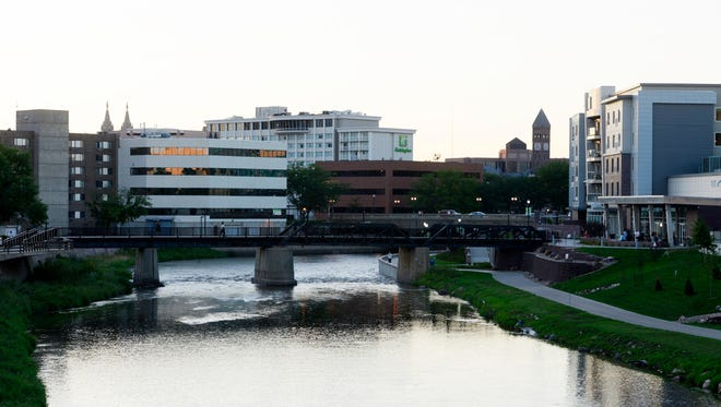 The Big Sioux River winds its way through downtown Sioux Falls in this file photo.