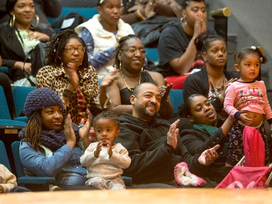 The audience enjoys a performance by the Omowale Cultural Society during a Kwanzaa celebration on Thursday, Dec. 29, 2016 at the Charles H. Wright Museum of African American History in Detroit.