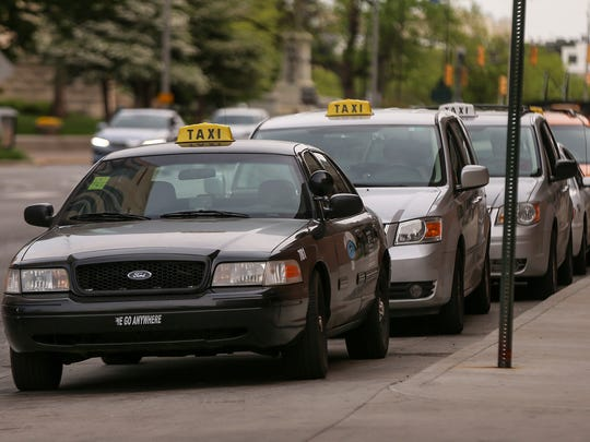 Taxis line up in downtown Indianapolis on Wednesday,