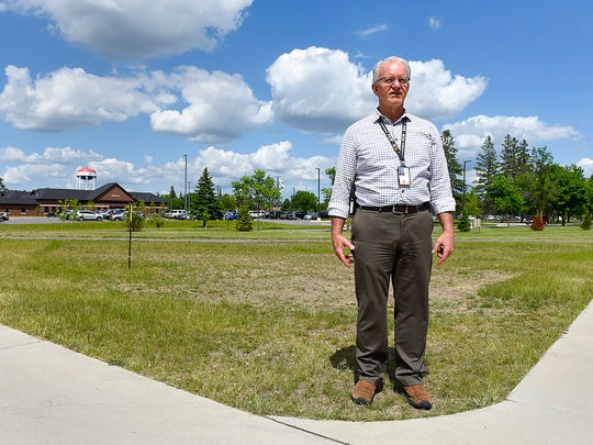 Jonathan Copeland, general engineer, show a field containing wells for the geothermal system that heats and cools a cluster of new buildings, Thursday, June 8, at the St. Cloud VA Health Care System.
