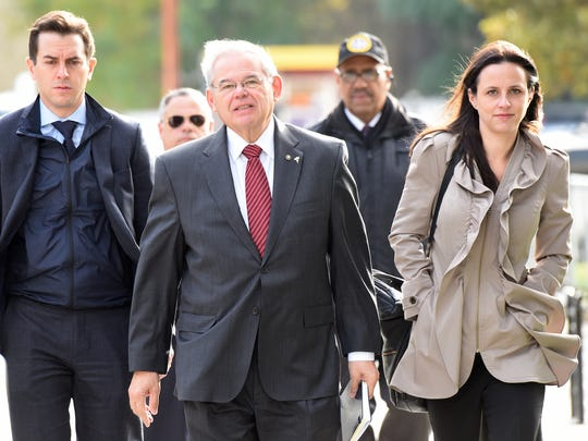 Senator Bob Menendez with his children Robert and Alicia Menendez, arrives at Martin Luther King Jr. Federal Courthouse on Thursday, November 9, 2017 to wait while the jury continues to deliberate in his corruption trial.