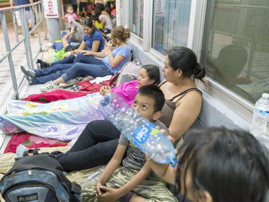 Migrants wait at Port of Entry