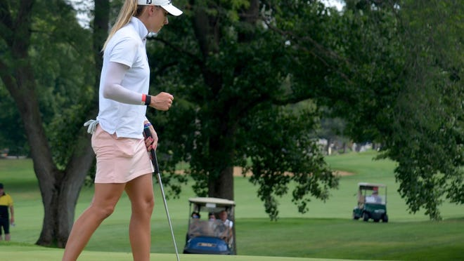 Gabrielle Shipley pumps her fist after sinking a putt on the 18th hole of the Symetra Tour's FireKeepers Casino Hotel Championship on Sunday at the Battle Creek Country Club.