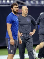 Indianapolis Colts quarterbacks Matt Hasselbeck (8) and Andrew Luck prior to the Houston Texans game Oct. 8 at NRG Stadium in Houston, Texas.