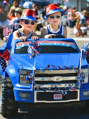 Brothers Hunter and Cole Stine, 3 and 4 respectively, couldn't have looked much more patriotic as they drove their way along the route of the kiddie parade Saturday morning, July 2, 2016, during the Annandale Fourth of July Celebration.