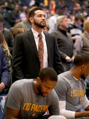 Indiana Pacers assistant coach David McClure works from behind the players on the bench during a timeout of their game against the Detroit Pistons Wednesday, March 4, 2017, evening at Bankers Life Fieldhouse.