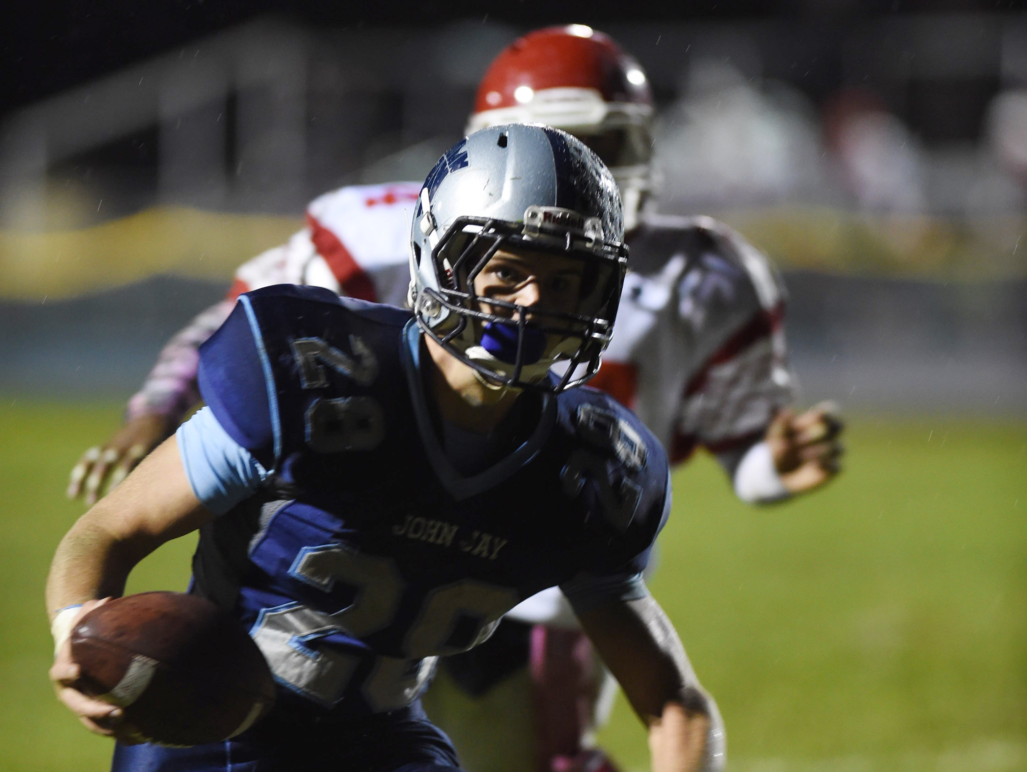 John Jay's Danny Diedrich crosses the goal line for the two point conversion in the third quarter during Friday's home game versus North Rockland.