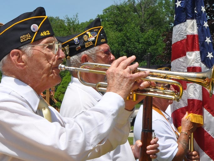 Robert Schlatter from the West Lafayette American Legion Post plays taps as an American flag is retired at the Flag Day ceremony at the Indiana Veteran's Home. | By Eric Schlene / For the Journal & Courier.