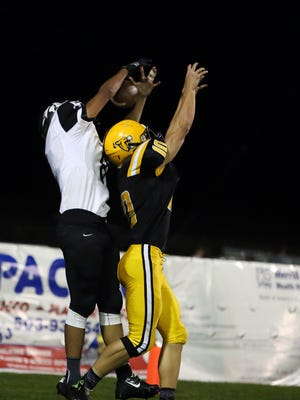 Cascade's Jaaron Bruce tries to intercept a pass intended for Sisters' Christopher Luz during a game on Friday, Sept. 9, 2016, at Cascade High School. Cascade defeated Sisters 12-10.
