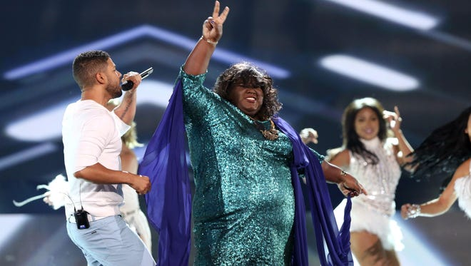 """Jussie Smollett, left, and Gabourey Sidibe of the """"Empire"""" cast perform at the Teen Choice Awards at the Galen Center on Sunday, Aug. 16, 2015, in Los Angeles."""