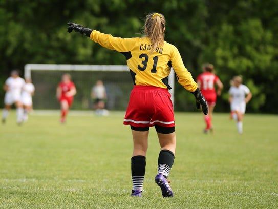 Directing her defense is Canton senior goalie Jordan