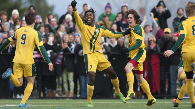 Vermont's Brian Wright (7) and Elliot Maker (27) celebrate a goal during the America East men's soccer championship game between the Binghamton Bearcats and the Vermont Catamounts at Virtue Field on November 15, 2015 in Burlington.