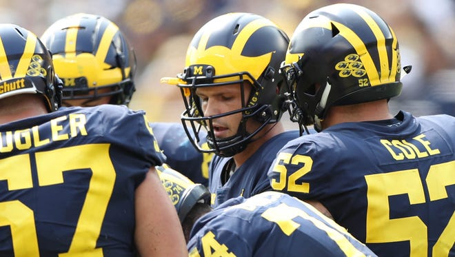 Michigan quarterback Wilton Speight calls a play in the huddle during the third quarter against Air Force, Saturday, Sept. 16, 2017 at Michigan Stadium.