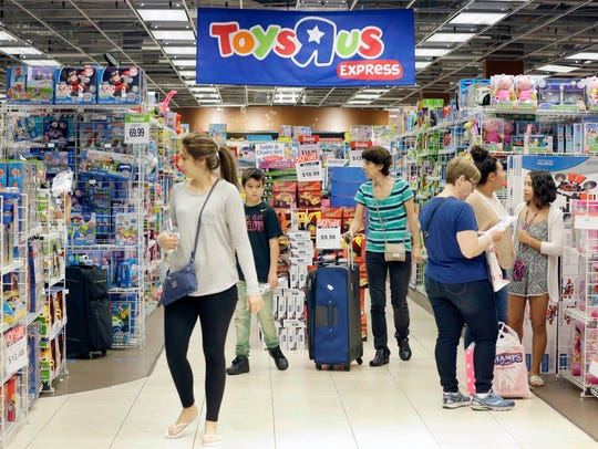 Shoppers browse a Toys R Us store in Miami on Nov. 25, 2016. The retailer announced last week that it is liquidating all 735 of its stores in the United States.