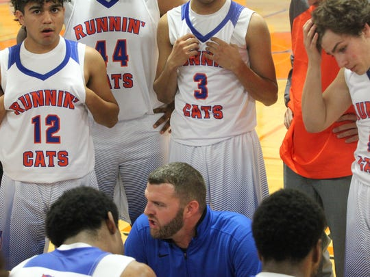 Central High School boys basketball coach Dustin Faught talks things over during a game against Kerrville Tivy at the Doug McCutchen Memorial Tournament at Babe Didrikson Gym on Thursday, Nov. 30, 2017.