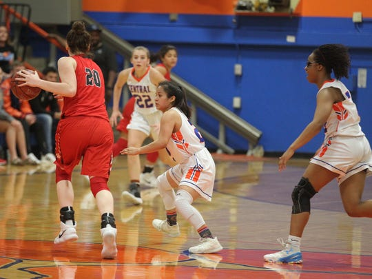 Central High School's Victoria Lopez (center) played strong defensively in the Lady Cats' 43-31 District 8-6A win against Belton at Babe Didrikson Gym on Friday, Feb. 2, 2018.