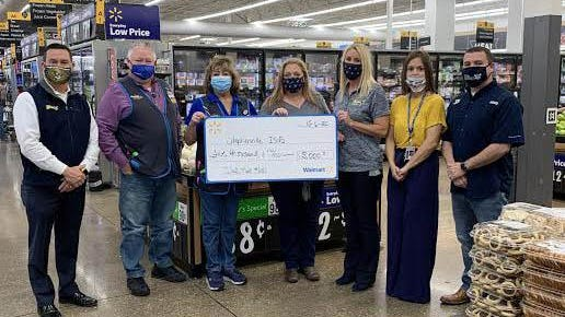 Walmart donated $5,000 to help partner with SISD and the SISD Education Foundation to fund the school supply project, Stocking the Hive. Left to right are:  Matt Underwood, Steve Chapman, Lisa Billings, Kathy Hampton, Kelly Magin, Teri Hodges and Shelby Womack.