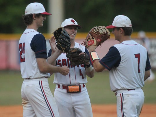 Wakulla Christian pitcher Jacob Dismuke (left), third baseman Aaron Collins and first baseman Aiden Driscoll-Sadusky get set for an inning.